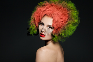 elegant fashionable woman with green hair