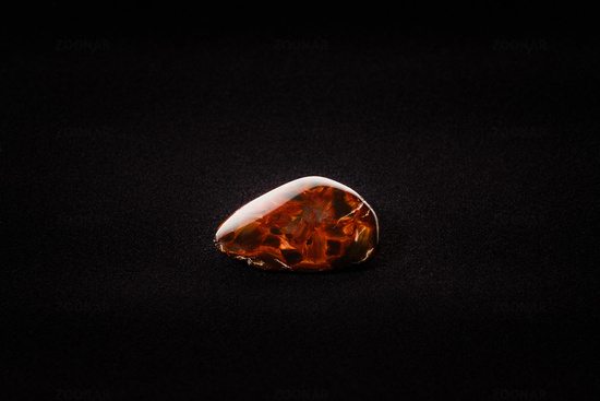 Piece of pietersite originating from Namibia Africa on velour fabric. Metamorphic gem stone type of tiger eye.