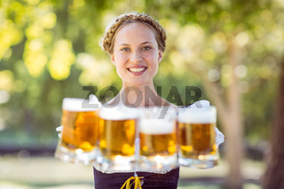 Pretty oktoberfest blonde holding beers