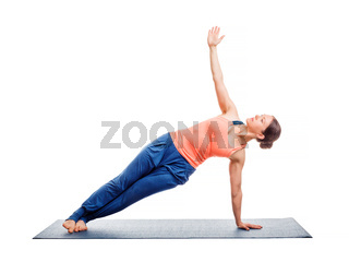 Woman doing yoga asana Vasisthasana