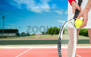 Composite image of athlete holding a tennis racquet ready to serve