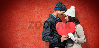 Composite image of festive couple in winter clothes