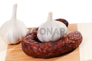 smoked sausage and two garlic bulbs