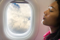 young beautiful woman resting on airplane
