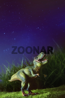 Tyrannosaurus on grass at night