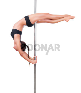 Young woman engaged in pole dancing isolated