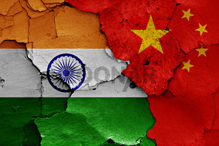 flags of India and China painted on cracked wall