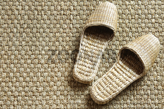 Sea grass spa slippers on woven carpet
