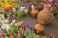 Water Container Earthenware Jugs Inside Flower Bed in Outdoor