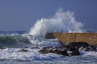 Wave splash near the pier of lighthouse, Porto, Portugal