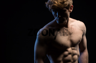 Portrait of an attractive man with naked torso