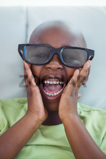 Close up of a boy wearing 3d glasses for a moive