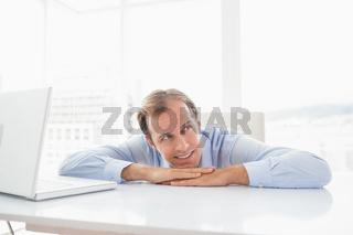 Happy businessman at his desk