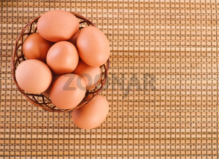 Still Life-eggs in wicker basket