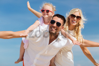 happy family having fun over blue sky background