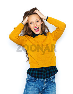 happy young woman or teen girl in casual clothes