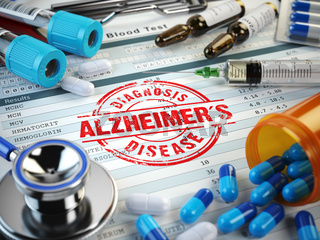 Alzheimers disease diagnosis. Stamp, stethoscope, syringe, blood test and pills on the clipboard with medical report.