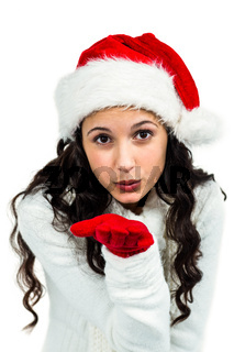 Attractive woman with red gloves blowing kiss