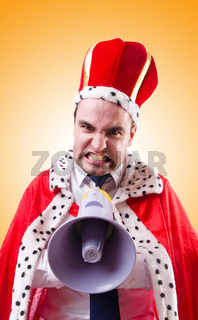 King businessman with loudspeaker isolated on white