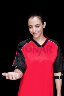 Female athlete posing with elbow pad