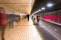 Pedestrians and cyclists in tunnel under Central Station, Amsterdam, Netherlands, Europe
