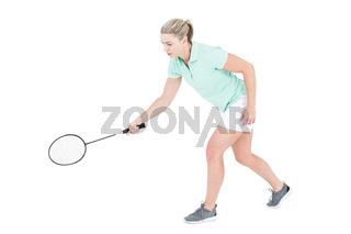 Pretty blonde playing badminton