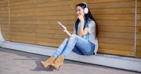 Attractive young woman listening to her music