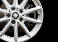 Silver modern car wheel on black background