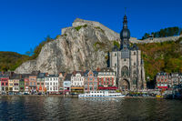 Old buildings, citadelle on rock, landmark church in Dinant Belgium