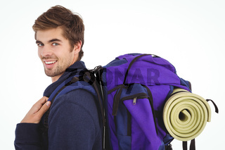 Side view of happy man with backpack