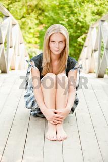 Woman sits