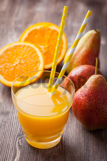 Delicious and healthy homemade smoothie with orange and pears