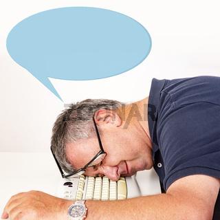 Man falls asleep on computer keyboard
