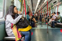 Passengers sit in a train from Hong Kong to Shenzhen