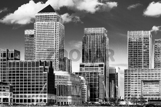 Canary Wharf buldings with clouds in black and white, London, UK