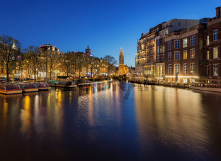 Beautiful night cityscape with traditional old houses in Amsterdam, Netherlands