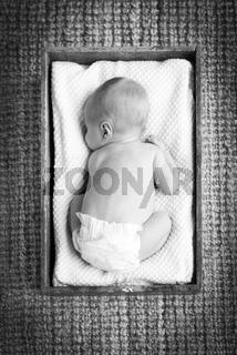 Newborn Baby In Crate Black and White