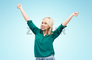 smiling young woman in shirt and jeans