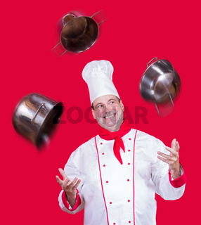 cheerful cook juggles with pot
