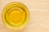 Vegetable oil in glass cup.
