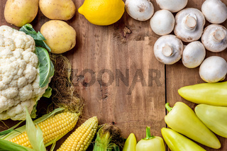 The multicolored vegetables on wooden table