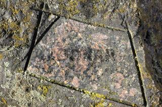 Natürliche und polierte Oberfläche eines Filipstad Granit, Nahaufnahme
