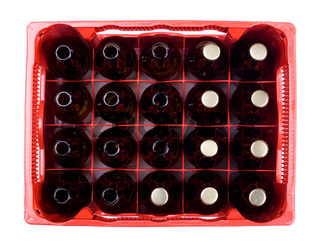glass empty and full bottles of beer in crate