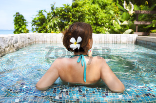 Young woman relaxing in spa pool