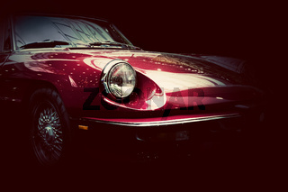 Retro classic car on dark background. Vintage, elegant
