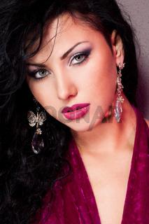 elegant fashionable woman in violet dress