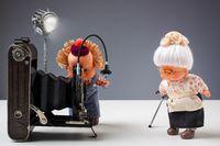 Nostalgic photographic moment with dolls