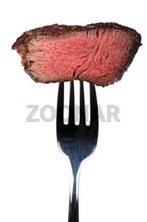 gegrilltes Steak auf einer Gabel
