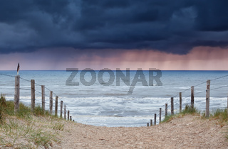 rain and storm coming from North sea to beach