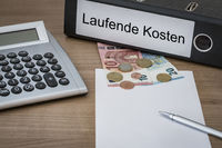 Laufende Kosten written on a binder